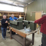 Desmond, David, and Rick from the Thurgoona Men's Shed constructing Squirrel Glider nest boxes for Albury Conservation Company, 15 July 2014 (Photo by Sam Niedra)